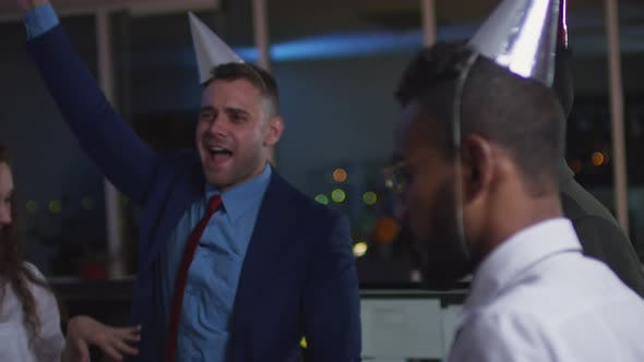 Thumbnail for Coworkers Drinking and Dancing at Corporate Party