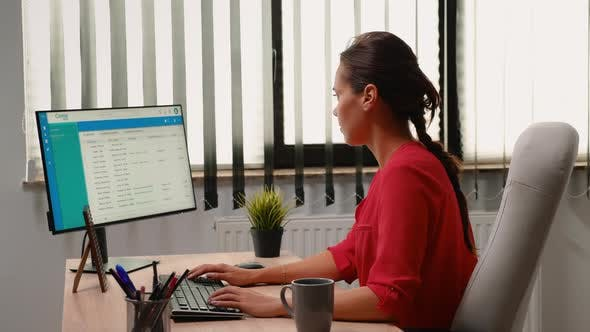 Administrator Working Alone in Workplace