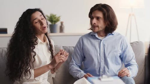 Young Emotional Spouses Talking at Personal Psychological Consultation Arguing and Quarreling on