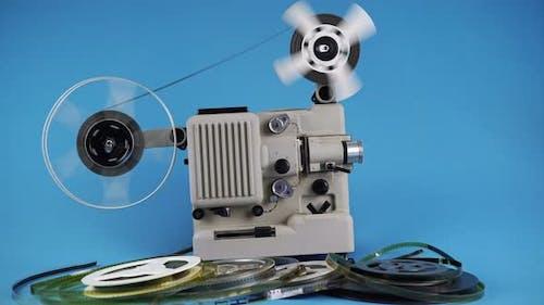 Rewinding Old Movies On Retro Movie Projector
