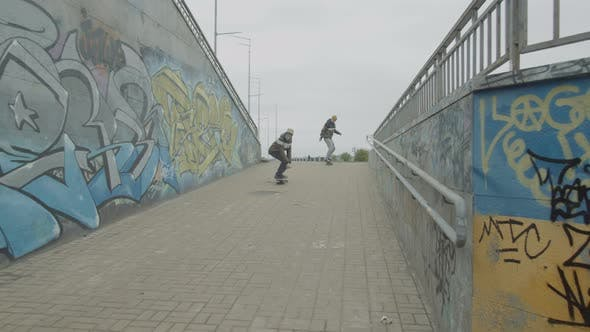 Thumbnail for Young Skaters Riding Down Descent To Underpass