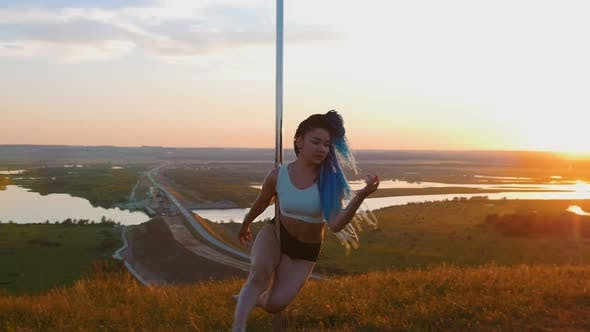 Thumbnail for Pole Dance on Sunset - Sexy Woman with Long Blue Braids Dancing