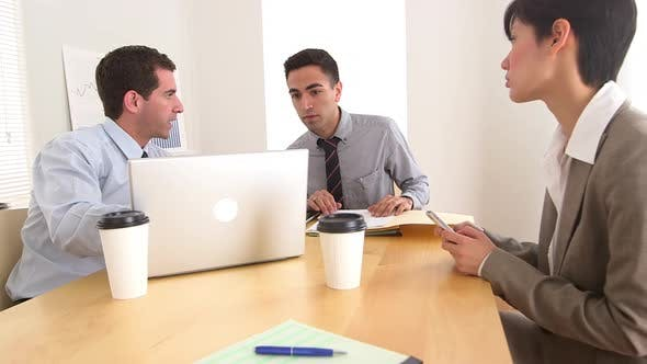 Thumbnail for Business colleagues collaborating at desk