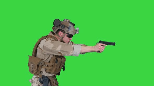 Modern Soldier, Counter Terrorist Squad Fighter Aiming and Shooting with Pistol on a Green Screen