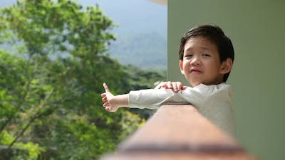 Cute Asian Child Playing At Balcony