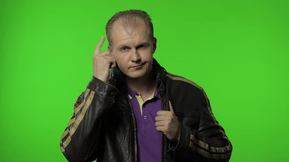Thumbnail for You Are Crazy, Out of Mind. Annoyed Man Pointing at Camera and Showing Stupid Gesture, Blaming Idiot