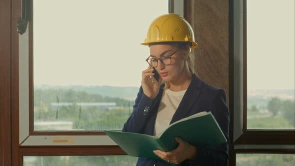 Thumbnail for Engineer at a Construction Site Making a Business Call