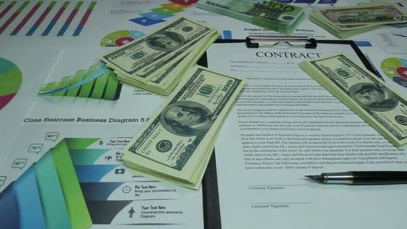 Thumbnail for Inancial Business Contract And Money On The Desk In The Office