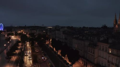 Bordeaux City Street at Night From Aerial Perspective with Church in Frame