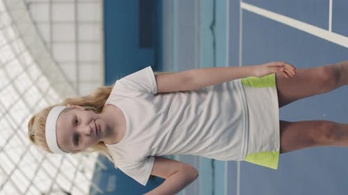 Little Girl With Tennis Racket On Court