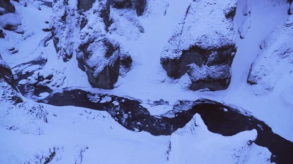 Thumbnail for Large Snow Covered Valley with Rushing Water Below in Winter Iceland