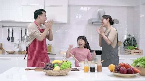Family dancing in kitchen