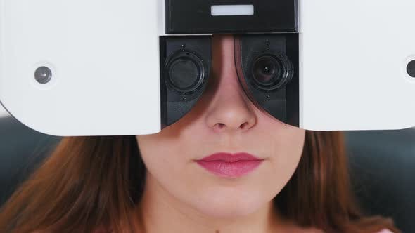 Thumbnail for Young Woman Checking Her Visual Acuity with a Special Optometry