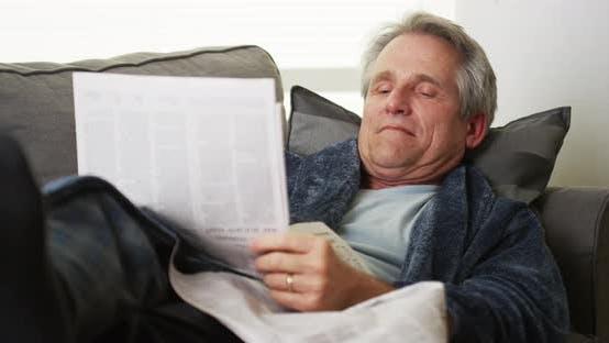 Thumbnail for Senior falls asleep reading newspaper