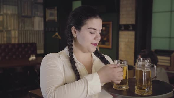 Cover Image for Plump Waitress with Pigtails in White Blouse Sneaks a Drink From a Customer's Glass
