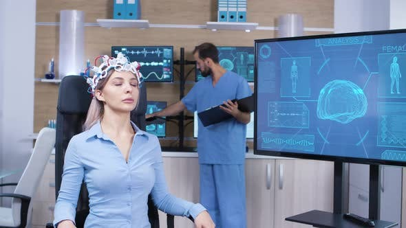 Cover Image for Female Patient Falling Asleep While Wearing Brain Activity Scanner