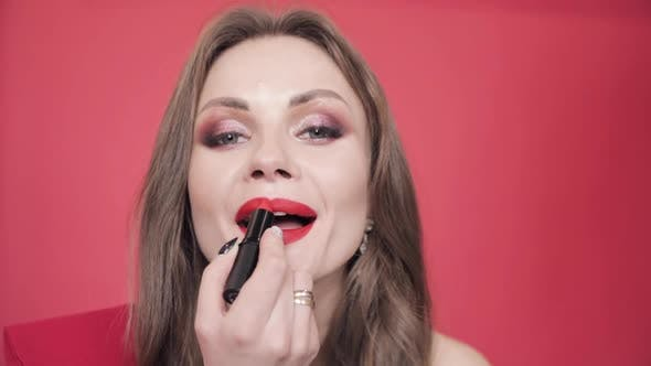 Thumbnail for Young Girl Holding Red Lipstick and Finishing Her Makeup
