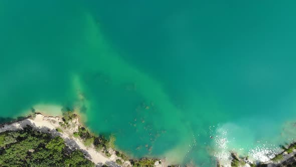 Thumbnail for Aerial View of a Blue Lake Surrounded By Forest