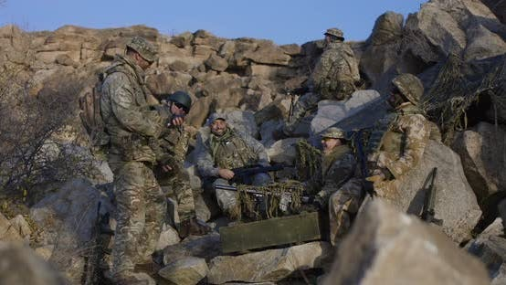 Thumbnail for Soldiers Taking a Break and Laughing