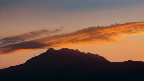 Cotacachi, Ecuador, Timelapse  - Warm sunset over the clouds in Andes