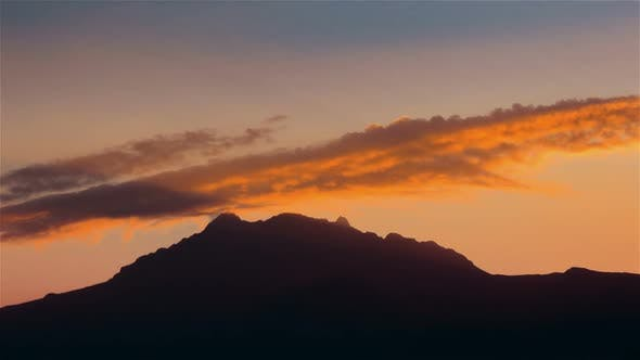 Thumbnail for Cotacachi, Ecuador, Timelapse  - Warm sunset over the clouds in Andes
