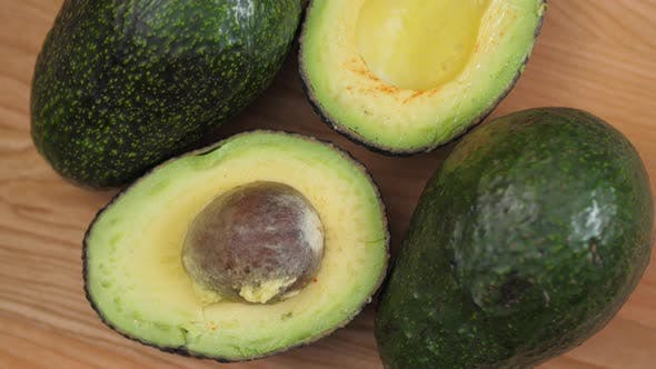 Thumbnail for Avocado Halves With Nut Spinnin On Cutting Board 03