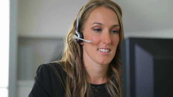 Businesswoman talking with headset in office