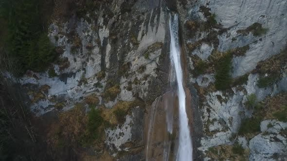 Thumbnail for Drone video of a waterfall in Wagitalersee Switzerland.