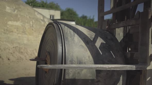 Thumbnail for Loader Putting Rolled Conveyor Belt on Ground and Leaving. Process of Cement Production on
