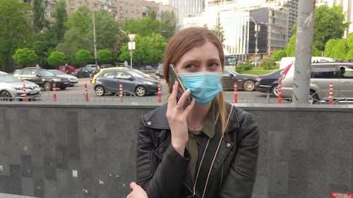 Masked Woman Calling