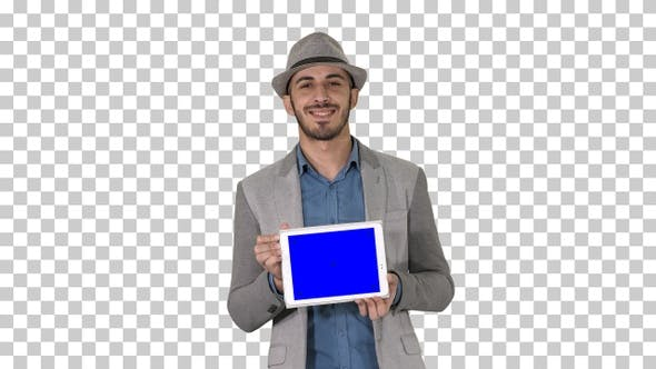 Thumbnail for Casual man in a hat walking and showing digital tablet