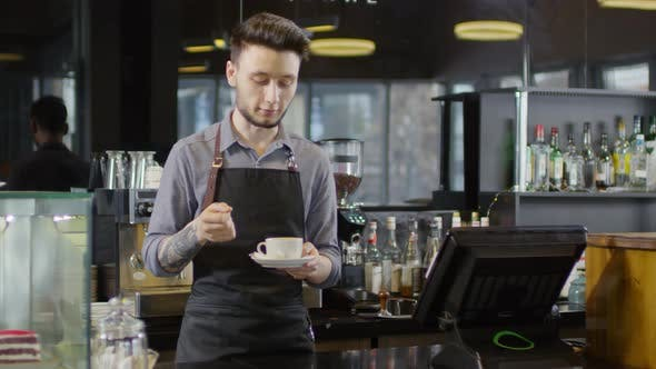 Thumbnail for Caucasian Male Barista Sharing Coffee-Making Expertise