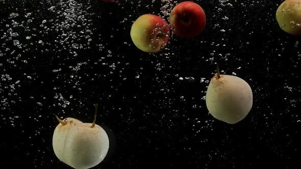 Thumbnail for Ripe Fruits Colorful Apples and Yellow Pears Falling Into Water with Splash Bubbles Black Background