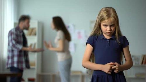 Frightened Girl Nervously Twisting Fingers, Scared by Parents Quarrel, Violence