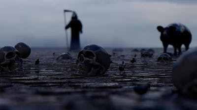 Fearful Death Executioner and Skulls on the Ground