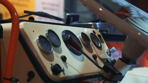 Thumbnail for Close-up of Retro Car Dashboard and Steering Wheel in Milk Color