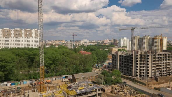 Thumbnail for Construction Site Residential, Tower Cranes Working on Building, Cityscape, Sunny Day Moving Clouds