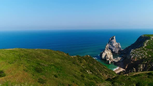 Thumbnail for Camera Rises Up To Breathtaking Ocean Shore View From Green Meadow