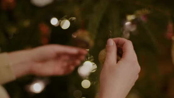 Thumbnail for Young Woman Decorating Christmas Tree At Home