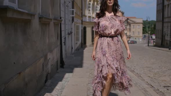 Cover Image for Fashion Hipster Style Girl Walks Through the Summer City Streets