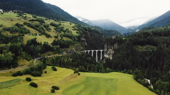 Thumbnail for Drone Flying Towards Landwasser Viaduct Bridge, World Famous Heritage Sight in Amazing Summer