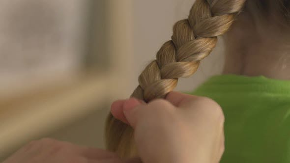 Thumbnail for Mother Braiding Blonde Daughter's Hair, Hairstyle, Family Relations and Care