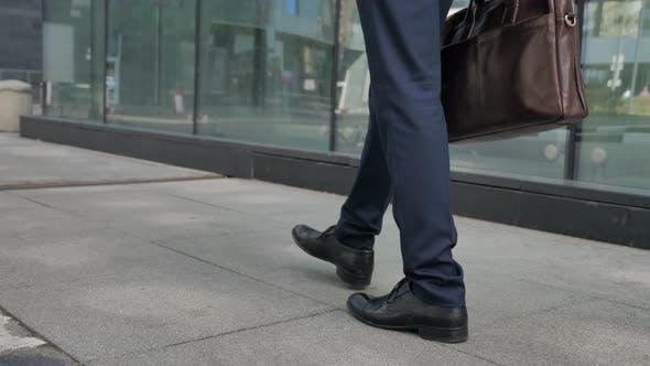 Walking feet of Businessman Going Away