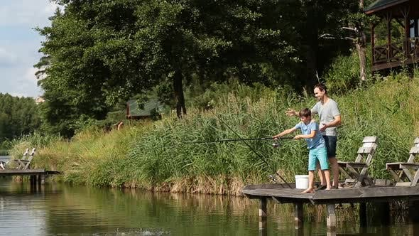 Thumbnail for Cute Teenager Learning To Fish on Lake in Summer