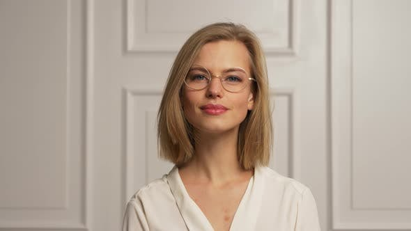 Thumbnail for Model Wearing White Blouse and Glasses