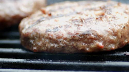 Homemade Meat Burger Is Grilled with Smoke.