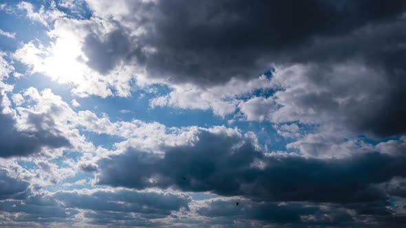 Timelapse of Gray Cumulus Clouds Moves in Blue Sky