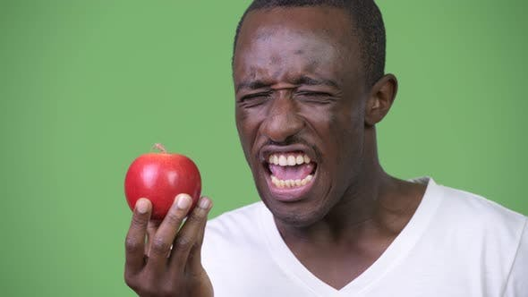 Thumbnail for Young African Man Disgusted with Red Apple