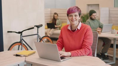 Young Businesswoman with Pink Hair Smiling