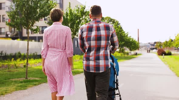 Thumbnail for Family with Baby in Stroller Walking Along City